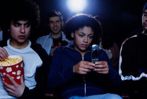 texting-in-movie-theatre